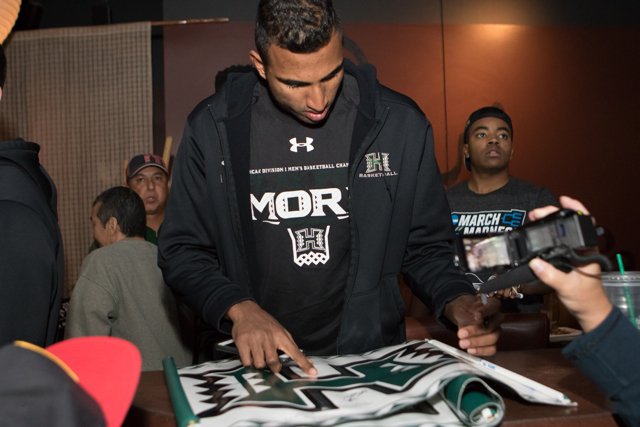 The University of Hawaii men's basketball team meets their fans at a pep rally at The Wave Island Sports Grill, Spokane, WA on March 17, 2016. Photo: Brandon Flores.